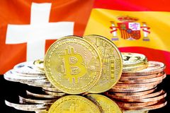 Bitcoins on Switzerland and Spain flag background. Concept for investors in cryptocurrency and Blockchain technology in the Switzerland and Spain. Bitcoins on stock image