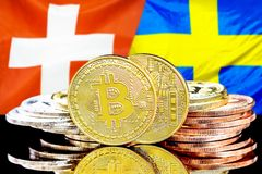 Bitcoins on Switzerland and Sweden flag background. Concept for investors in cryptocurrency and Blockchain technology in the Switzerland and Sweden. Bitcoins on royalty free stock photo