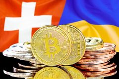 Bitcoins on Switzerland and Ukraine flag background. Concept for investors in cryptocurrency and Blockchain technology in the Switzerland and Ukraine. Bitcoins royalty free stock photo
