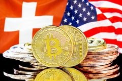 Bitcoins on Switzerland and USA flag background. Concept for investors in cryptocurrency and Blockchain technology in the Switzerland and United States of stock images