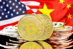 Bitcoins on USA and China flag background. Concept for investors in cryptocurrency and Blockchain technology in the United States of America and China. Bitcoins stock photos