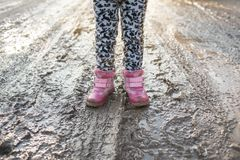 Free Concept - Is A Happy Childhood. Child In Swamp, Children`s Fun, Dirty Shoes, Life In The Village, Sunlight, Backlight Stock Image - 107148151