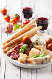 Concept of italian antipasto with cheese and sausage Royalty Free Stock Photography