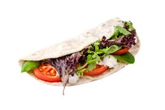 The concept of Italian cuisine. Vegatarian piadina with tomatoes, mozzarella cheese, mix lettuce, arugula and sauce on white. The concept of Italian cuisine royalty free stock photo
