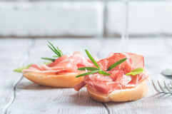 Concept of italian food with  bruschetta. With prosciutto on white background Stock Photos