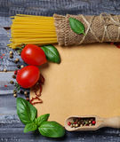 Concept of italian food with pasta, tomato, basil Stock Image