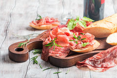 Concept of italian food with red wine, melon and prosciutto Stock Photos