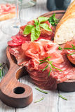 Concept of italian food with red wine, melon and prosciutto Stock Photo