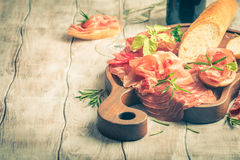 Concept of italian food with red wine, melon and prosciutto Stock Photography