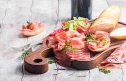 Concept of italian food with red wine, melon and prosciutto Royalty Free Stock Photos