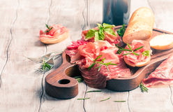 Concept of italian food with red wine, melon and prosciutto Royalty Free Stock Photography