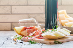 Concept of italian food with red wine, melon and prosciutto Stock Images