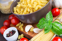 Concept Italy food - pasta, cherry tomatoes, spices Stock Image