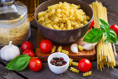 Concept Italy food - pasta, cherry tomatoes, spices on a wooden Stock Image