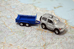 Concept jeep with trailer toy car on italy map. Concept small jeep with trailer toy car on italy map Stock Photo
