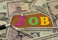 Concept of job search - magnifying glass and money Royalty Free Stock Image