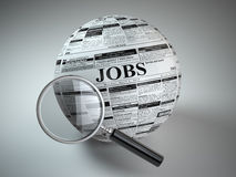 Concept of job search . Newspaper sphere and loupe. Stock Image