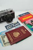 Concept of journey around Japan with vintage photo camera and guidebook on white background. 12.05.2018, Moscow, Russia. Concept of journey around Japan with stock photo