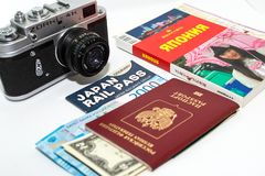 Concept of journey around Japan with vintage photo camera and guidebook on white background. 12.05.2018, Moscow, Russia. Concept of journey around Japan with stock photography