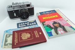 Concept of journey around Japan with vintage photo camera and guidebook on white background. 12.05.2018, Moscow, Russia. Concept of journey around Japan with stock images