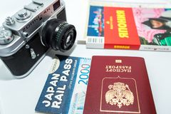 Concept of journey around Japan with vintage photo camera and guidebook on white background. 12.05.2018, Moscow, Russia. Concept of journey around Japan with royalty free stock photography