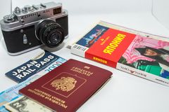 Concept of journey around Japan with vintage photo camera and guidebook on white background. royalty free stock photos