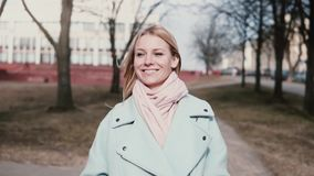 Concept of joy and happiness. Slow motion. Portrait of happy cute Caucasian woman front view. Cheerful excited 20s lady. Concept of joy and happiness. Slow stock video footage
