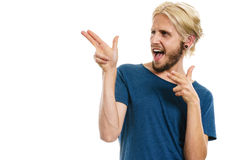 Young man laughing pointing with fingers. Concept of joy, positive emotion. Happy joyful young man, stylish bearded male smiling laughing, pointing with fingers Royalty Free Stock Images
