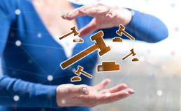 Concept of judgment. Judgment concept between hands of a woman in background royalty free stock photo