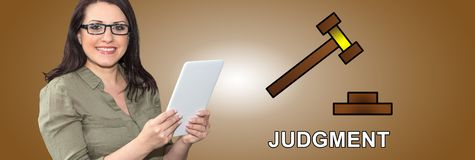 Concept of judgment. Woman using digital tablet with judgment concept on background stock photography