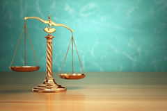 Concept of justice. Law scales on green background. Stock Photos