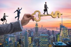 The concept of key to financial success and prosperity. Concept of key to financial success and prosperity Stock Photos