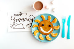 Concept kid breakfast with pancake top view on white background.  Stock Photography