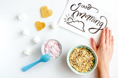 Concept kid breakfast with yogurt top view white background Stock Image