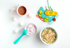 Concept kid breakfast with yogurt top view white background Stock Photo