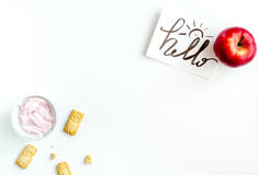 Concept kid breakfast with yogurt top view white background Royalty Free Stock Image