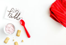 Concept kid breakfast with yogurt top view white background Stock Images