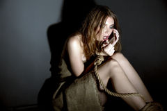 Concept. Kidnapped model asks for help on phone Stock Photos