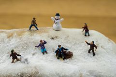 Concept Kids playing in the snow. Playing on a winter cake Royalty Free Stock Photos