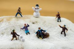 Concept Kids playing in the snow. Playing on a winter cake Stock Images
