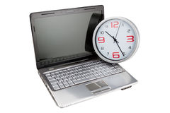 Concept laptop computer and desktop clock. Stock Image