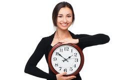 Concept for lateness, woman with clock Stock Photo