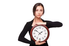 Concept for lateness, woman with clock Royalty Free Stock Photo