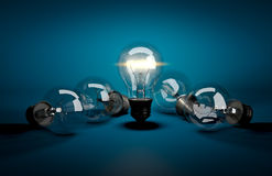 Concept of leadership. Glowing light bulb among dark ones lying Stock Images