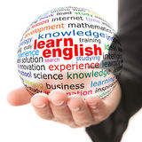 Concept of learning English. Transparent ball with inscription learn English in a hand Stock Photography