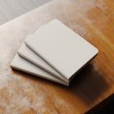 Concept leeg notitieboekje drie met ambachtdocument dekking op houten bureau Leeg horizontaal model het 3d teruggeven Stock Foto's