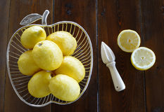 Concept with lemons and citrus juicer Stock Photos