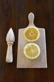Concept with lemons and lemon squeezer Royalty Free Stock Photos