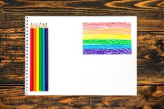 Colored pencils painted in LGBT colors and white card. Concept of LGBT royalty free stock image