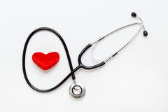 Concept of life stethoscope on white background with plush heart Stock Images